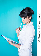 young caucasian business woman holding diary - young...
