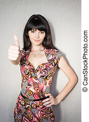 successful woman holds his thumb up. - A young, successful...