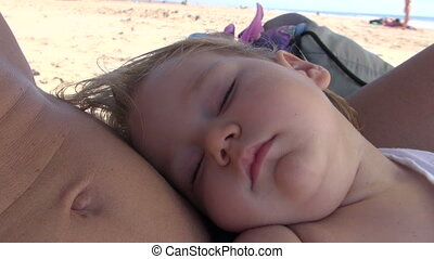 baby sleeping on mom belly - thirteen month old baby face...