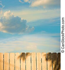 Other Side of the Fence - View over a fence toward a bright...
