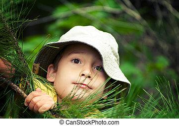 explorer boy - young boy wearing a hat pretending to be an...