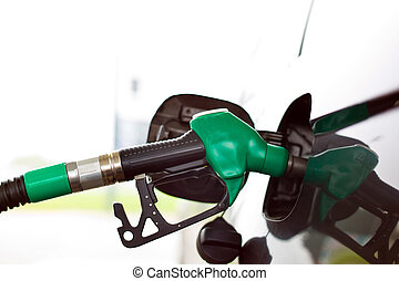 tap for gasoline a gas station