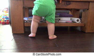back legs of standing baby