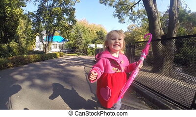Baby girl running in park