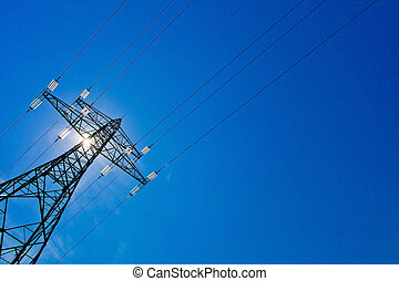 power line with sun - a high voltage towers for power...