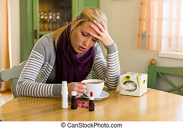 woman has a cold flu season - woman on sick leave with tea...