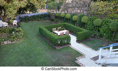 Garden setting with hedging - Hedging surrounds a garden...