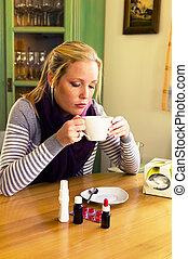 woman has a cold. flu season