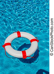 lifebuoy in a pool - an emergency tire floating in a...