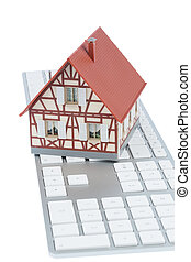 house on keyboard symbol photo for home purchase and rental...
