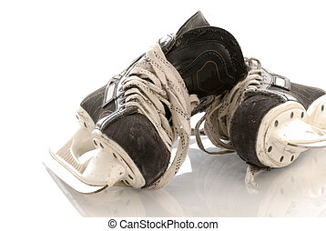 ice hockey skates with reflection on white background