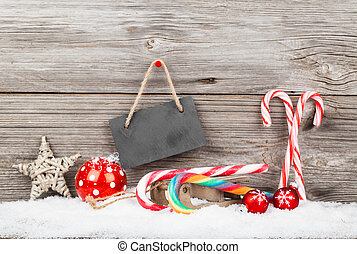 Christmas decoration with xmas canes, over wooden background