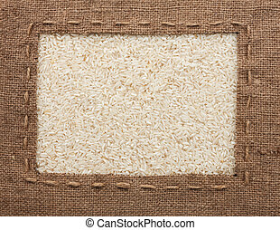 Frame made of burlap with the line lies on rice grains, can...
