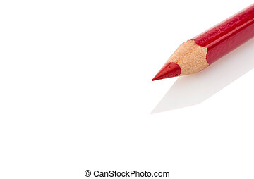 red pencil - a red colored pencil lying on a reflective...