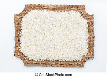 Figured frame of burlap with  rice, on a white background