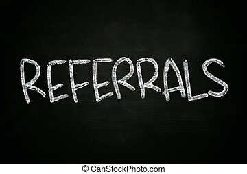Referrals Concept - The word referrals written with chalk on...