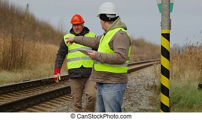 Foreman with tablet PC talking with the worker
