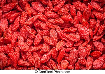 Dried goji berries as a background
