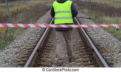 Railway employee behind warning