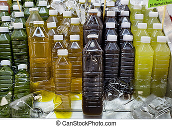 Assortment of cold tropical fruit juice in bottles