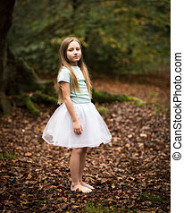 Young Girl In White Tutu Alone in the Forest - Portrait of a...