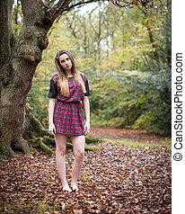 Portrait of a Beautiful Teenage Girl Standing in a Forest -...