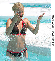 happy woman in the pool