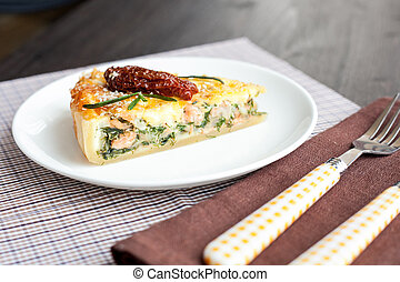 Piece of pie with spinach and fish salmon - quiche with...