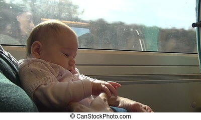 little baby on train with mom