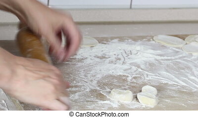 Preparation of dough for baking - Beautiful woman's hand to...