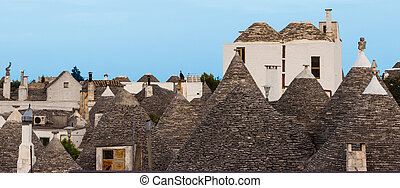 Trulli village in Alberobello, Italy The style of...