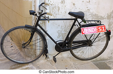 Used bicycle leaning on the wall for sale
