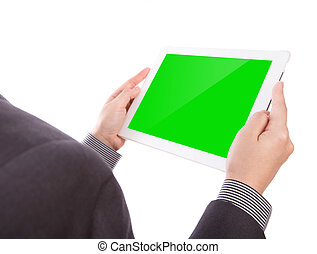 Business man holding a touch screen device with green screen...
