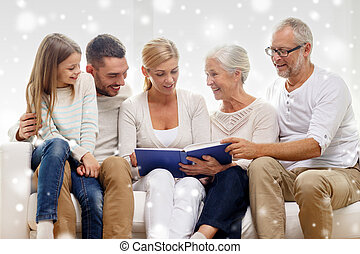 happy family with book or photo album at home - family,...
