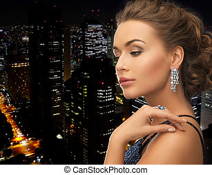 woman with earrings and ring - woman in evening dress...