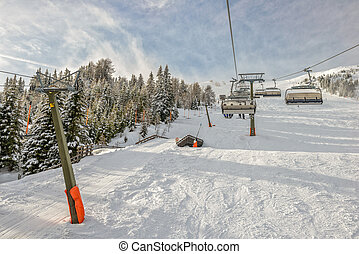 Chairlift at ski resort - Winter landscape with chairlift...