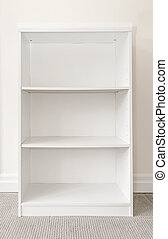 Empty white bookshelf - Empty white wooden bookshelf against...