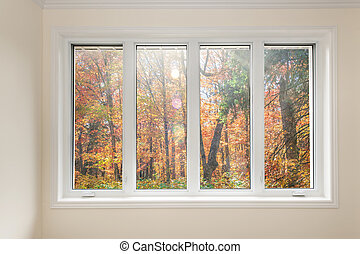 Window with view of autumn forest - Large four pane window...