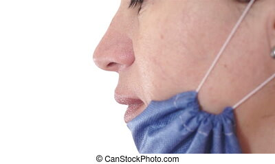 Nurse Puts On Mask Side View - Side view shot of a female...