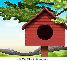 A birdhouse - A wooden birdhouse