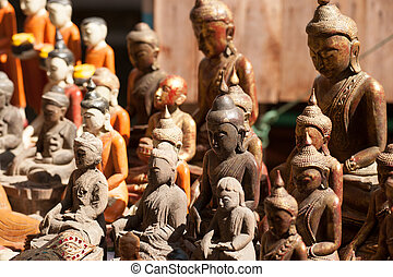 Wooden carving Buddhas souvenir.
