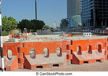 Road works - Close-up of orange barriers designating road...