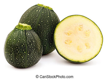 Courgettes - Round Courgettes whole and sliced on a white...