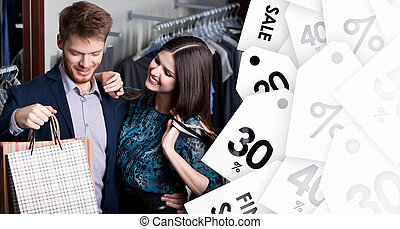 Attractive woman and young man are in the shop on sale -...