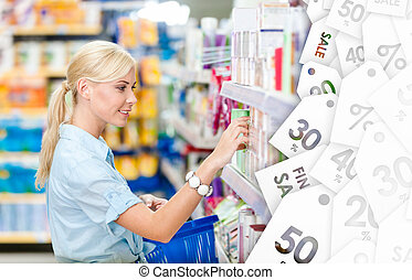 Profile of girl at the shop choosing cosmetics. Clearance sale