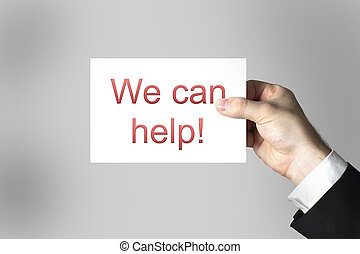 hand holding card sign we can help