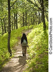 woman hiking at charming forest - woman hiking at gredos...
