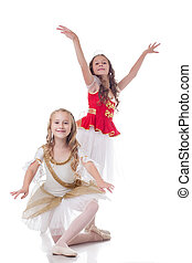 Smiling young ballerinas, isolated on white background