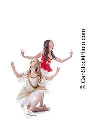 Duo of young artistic ballet dancers, isolated on white...