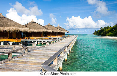 Beautiful vivid over beach with the water villas in the...